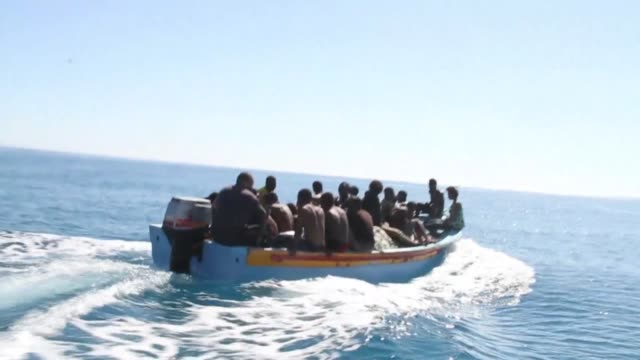 thirty five migrants including seven children are feared drowned after their inflatable craft sank off the libyan coast the coastguard says - drowning stock videos & royalty-free footage