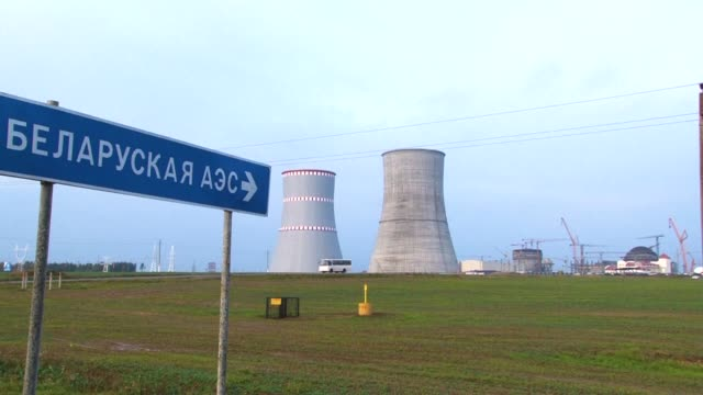 thirty years after the chernobyl disaster spewed radioactive clouds into the sky and sent shockwaves across europe belarus is building a nuclear... - nuclear power station stock videos & royalty-free footage