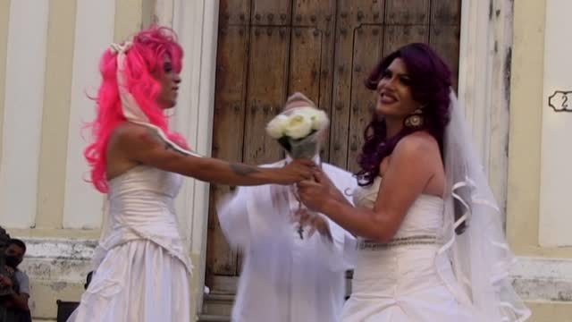 thirty-one-year-old cuban hairdresser alfredo dreams of arriving at a church for their wedding in havana dressed in white, riding on an old red... - mid adult stock videos & royalty-free footage