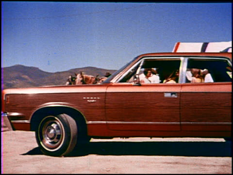 vidéos et rushes de this amc promotional short for the 1969 rebel sst features all the things that baby boomers remember about station wagons the fake wooden paneling... - 1960 1969