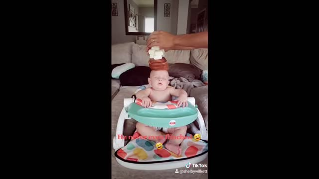 this baby fell asleep looking like buddha, so these parents took advantage and started stacking food. unfortunately they ran out of bread and had to... - buddha stock videos & royalty-free footage