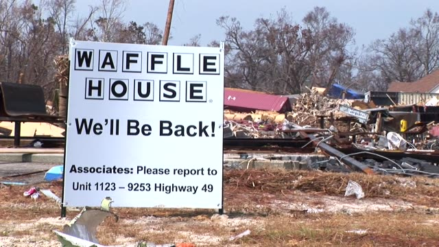 vídeos de stock e filmes b-roll de this beachfront waffle house in biloxi, mississippi was decimated by hurricane katrina as everything was ripped from the structure but some of the... - amarrotado