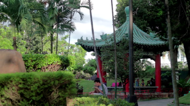 this chinese garden is located at the national park of the philippines. - classical chinese garden stock videos & royalty-free footage