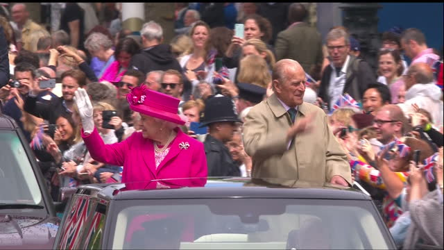 This clip contains a black gap third party content removed VOICED Ten thousand people gathered for the final day of the Queen's 90th birthday...