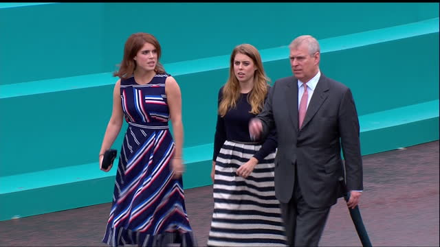 This clip contains background music which may require additional clearances CLEAN Exterior shots of Prince Andrew Princess Beatrice Princess Eugenie...