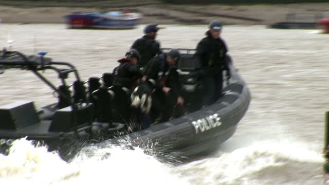 this clip contains black gaps third party content removed voiced a sightseeing ship on the thames became the scene of a mock gun battle today as... - counter terrorism stock videos & royalty-free footage