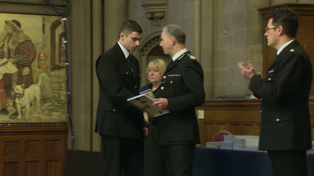 This clip contains black gaps third party content removed VOICED A special ceremony has been held to honour police officers and rail staff for their...