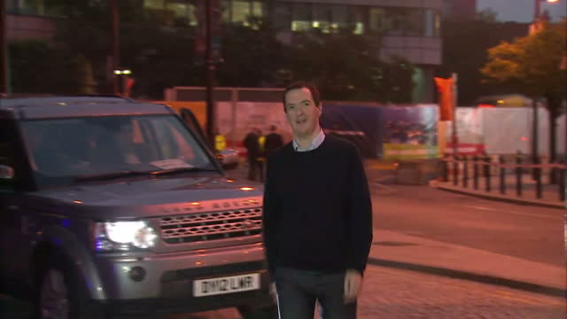 This clip contains flash photography CLEAN Exterior night shots of Chancellor George Osborne arriving in Manchester ahead of the Conservative party...