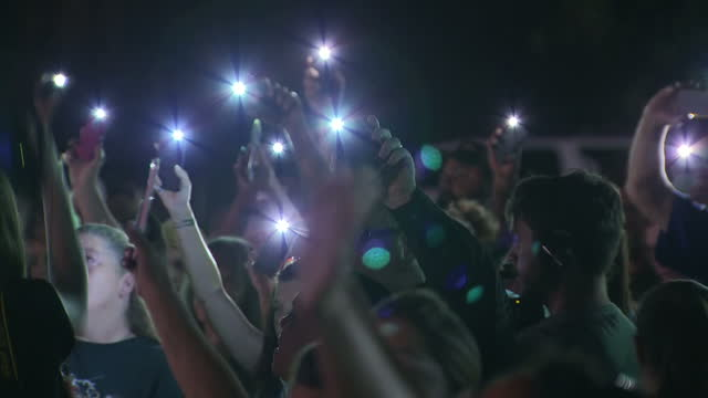 This clip contains music that may require additional thirdparty clearances CLEAN Night shots of residents attending a prayer vigil at a baseball park...