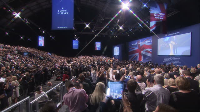 This clip contains music which may require additional clearances CLEAN Interior shots of Prime Minister David Cameron walking on stage to prolonged...