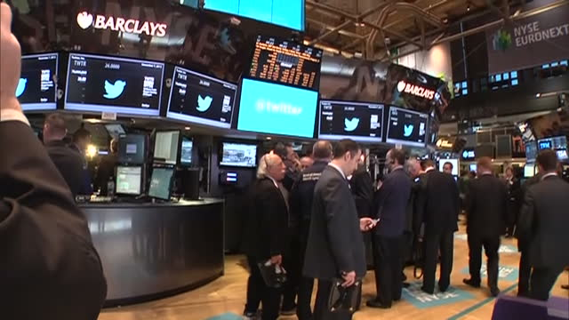 This clip is mute CLEAN Interior shots of crowds of traders on the trading floor of the New York Stock Exchange Twitter Launches on New York Stock...
