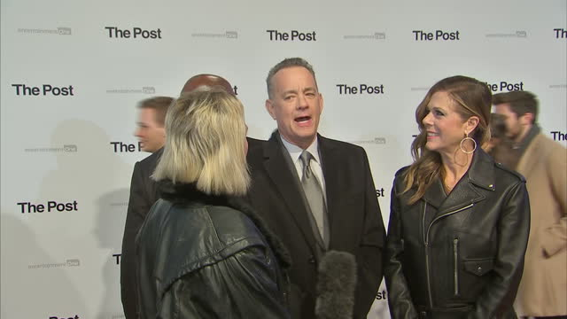This clip is part mute CLEAN Exterior shots of Tom Hanks and his wife Rita Wilson speaking to a reporter on the red carpet at the London premiere of...
