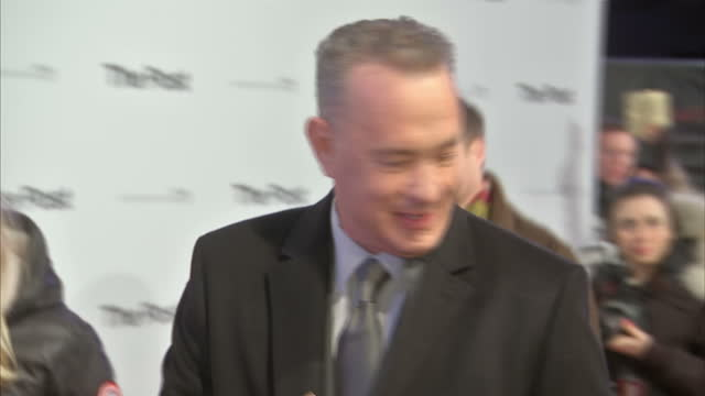 This clip is part mute CLEAN Exterior shots of Tom Hanks on the red carpet at the London premiere of The Post signing autographs and speaking to a...