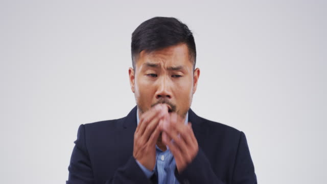 this cough's gonna keep him from the office - symptom stock videos and b-roll footage