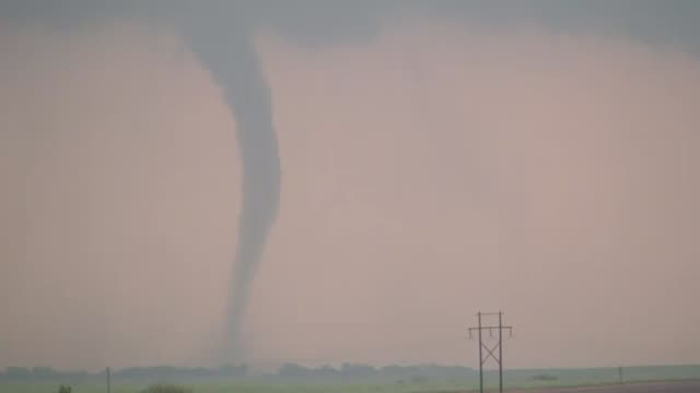 This dangerous tornado was shot south of Cheyenne, OK. at sunset. One of over 100 tornadoes reported in the Central Plains during a torando outbreak on Saturday, April 15, 2012.
