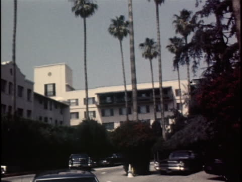 this first shot for this clip is a the beverly hills hotel during the daytime. you can see palm trees and a few cars parked out front of it. the... - see other clips from this shoot 1900 video stock e b–roll