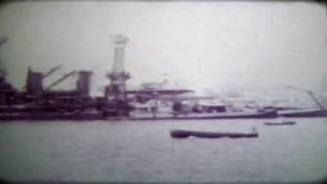 this footage of the japanese attack on pearl harbor was shot by cwo4 clyde daughtry the original footage has since been lost and the poor quality of... - militärschiff stock-videos und b-roll-filmmaterial
