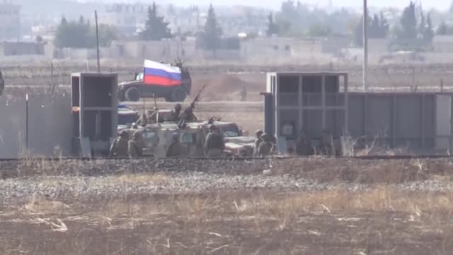 this footage taken from turkey's border province of sanliurfa on november 05, 2019 shows turkish and russian troops in armored vehicles conducting... - russia stock videos & royalty-free footage