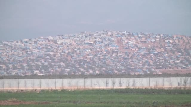 this footage taken from turkey's hatay province shows a concrete wall built along the border with syria and atma refugee camp in syria on september... - concrete wall stock videos & royalty-free footage