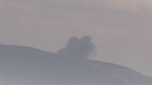 This footage taken from Turkey's southern Hatay province on the Syrian border shows smoke rising from PYD/PKK targets hit by Turkish war planes in...
