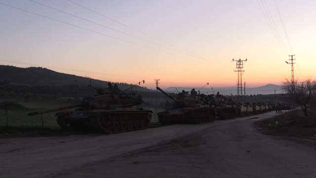 stockvideo's en b-roll-footage met this footage taken from turkey's southern kilis province on the syrian border shows turkish army continues its military shipment to border on the... - isis