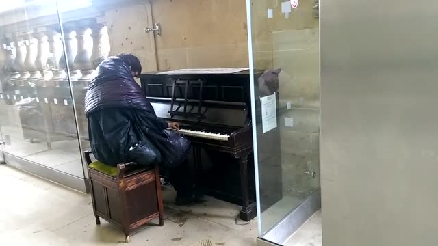 this homeless man at the local railway station in newcastle, england, was very pleased to have found a public piano from which to share his talent... - wet wet wet stock videos & royalty-free footage