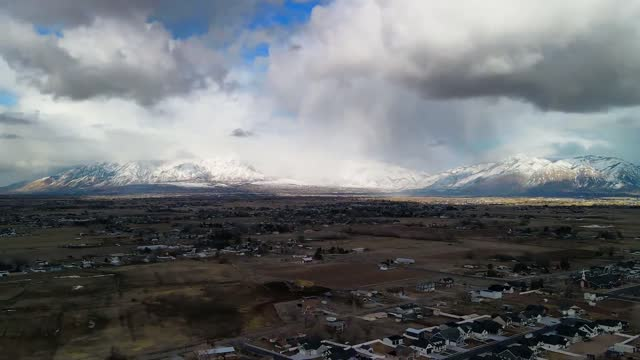 this hyperlapse was shot over an hour resulting in 46 seconds of footage, capturing a snowstorm coming up against the mountains of northern utah.... - utah stock videos & royalty-free footage