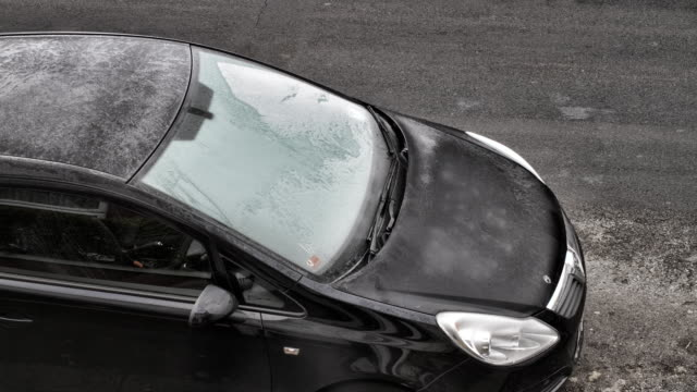 melting winter frost and ice on car windscreen hd video - metal clip stock videos and b-roll footage