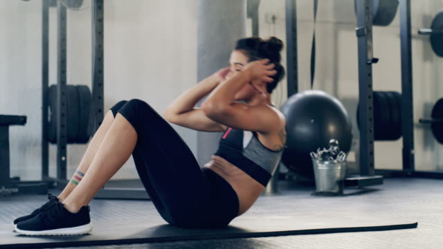 this is how you get a flat stomach ladies - sit ups stock videos & royalty-free footage