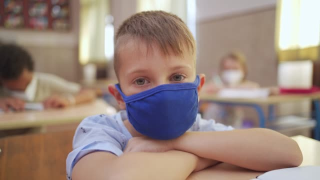 this is not what he expected on his first day at school during corona virus pandemic, everyone is so strict - relief emotion stock videos & royalty-free footage