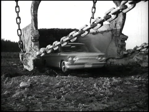 vídeos de stock e filmes b-roll de this is product worship footage at its most extreme in this chevysponsored montage a 1963 corvair emerges from a giant construction crane claw in a... - hovercraft