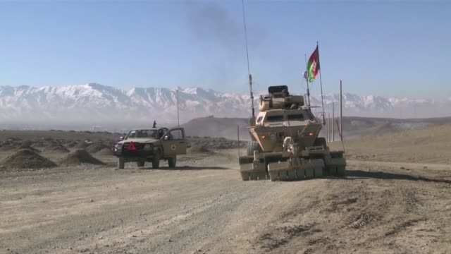 vídeos y material grabado en eventos de stock de this is the afghan national army in action demonstrating the value of their armored security vehicles supplied by the us for fighting the taliban - vehículo acorazado