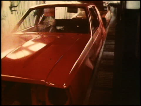 This is the first of 3 montages showing the assembly of American Motors iconic 1970s subcompact the Gremlin This montage shows factory workers spray...