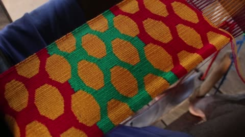 this is the production of ghanaian traditional cloth, kente at the accra arts center. the kente cloth is part of ghana's heritage and has widely been... - weaving stock videos & royalty-free footage