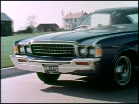 this is the second part of a 1973 american motors promotion film for its luxury car, the ambassador. clips include a blue hard top and green sedan... - country club stock videos & royalty-free footage
