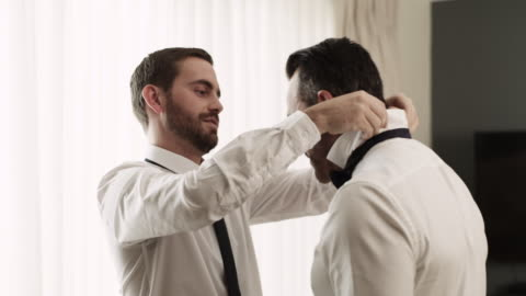 this is what a best man does - male friendship stock videos & royalty-free footage