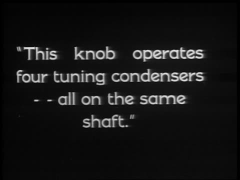 "b/w 1929 slate: ""this knob operates four tuning condensers -- all on the same shaft."" / industrial - 1920 1929 video stock e b–roll"