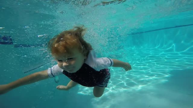 this little guy is only twentymonthsold but can swim and float and save himself in the pool amazing skills for a baby tristian is twentymonthsold and... - one baby boy only stock videos & royalty-free footage