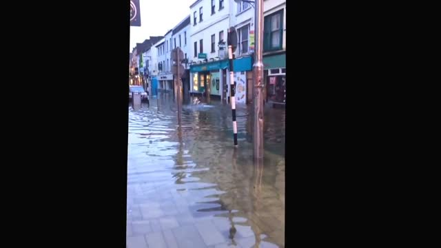 this man clad only in a pair of shorts was captured on february 2 swimming down the flooded main shopping street in the city of cork in southern... - swimming shorts stock videos & royalty-free footage