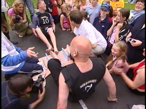 this might make you cringe a bit. the world toe wrestlings championships are held every year in the uk. it's pretty self explanatory but must be seen... - toe stock videos & royalty-free footage