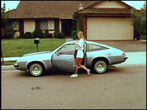 this news film introduces the 1975 chevy monza 22 hatchback a woman puts her tennis gear in the roomy cargo area and drives off to the tennis court... - chevrolet stock videos & royalty-free footage