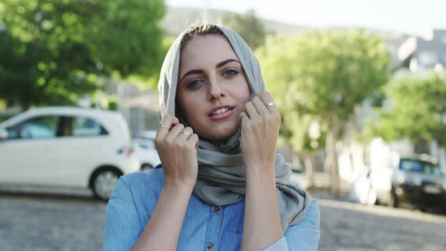 this scarf is great protection from the wind - middle eastern ethnicity stock videos & royalty-free footage