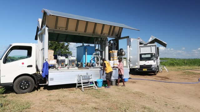 this shot shows a specialist truck that takes water straight from the river and purifies it to drinking standards, which is then used in the many... - drinking water stock videos & royalty-free footage