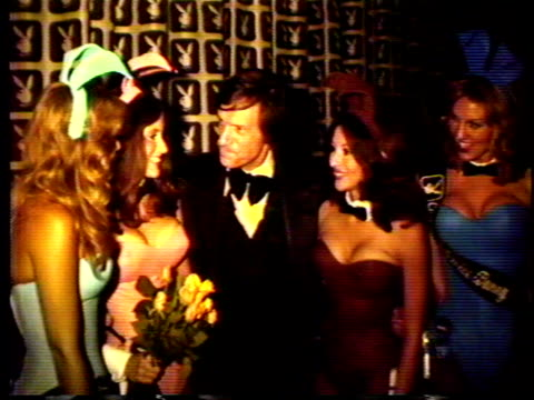 This video captures scenes from opening night of the Dallas Playboy Nightclub in 1977 The camera captures pictures of shelves lined with Playboy swag...
