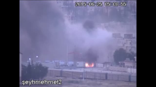 this video footaged from suruc district of turkey's sanliurfa province shows black smoke rises after an explosion in the syrian border town of kobani... - isil konflikt stock-videos und b-roll-filmmaterial