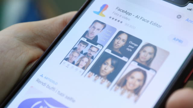 this video illustration shows faceapp application displayed on the screen of a smartphone the popular app is in the in the eye of a political storm... - mobile app stock videos & royalty-free footage