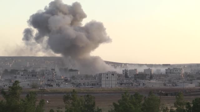 vídeos de stock e filmes b-roll de this video shot from sanliurfa southeastern province of turkey near turkishsyrian borderline shows that smoke rising in ayn alarab after the usled... - ataque aéreo