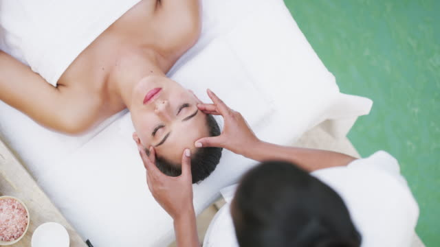 this your lazy day and you deserve it - head massage stock videos & royalty-free footage