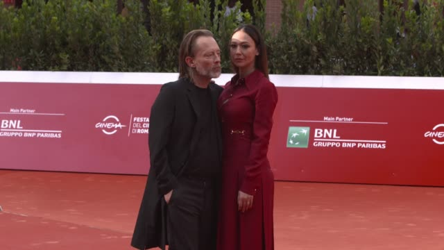 thom yorke, dajana roncione walk the red carpet during the 15th rome film festival on october 24, 2020 in rome, italy. - rome film festival点の映像素材/bロール
