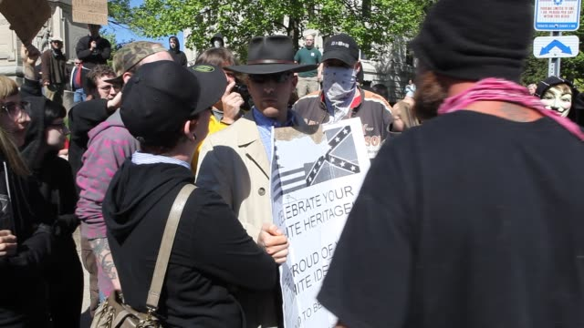 thomas buhls a member of the ku klux klan kkk stages a one man rally at the monroe county courthouse by holding a sign with an american and a... - confederate flag stock videos & royalty-free footage